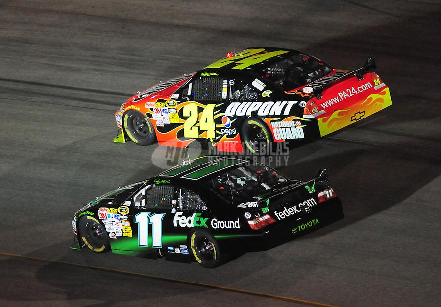 May 2, 2009; Richmond, VA, USA; NASCAR Sprint Cup Series driver Jeff Gordon (24) races alongside Denny Hamlin (11) for the lead during the Russ Friedman 400 at the Richmond International Raceway. Mandatory Credit: Mark J. Rebilas-