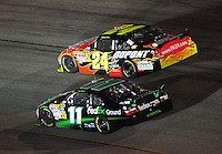 May 2, 2009; Richmond, VA, USA; NASCAR Sprint Cup Series driver Jeff Gordon (24) races alongside Denny Hamlin (11) for the lead during the Russ Friedman 400 at the Richmond International Raceway. Mandatory Credit: Mark J. Rebilas-