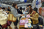 November 23, 2014, Tokyo, Japan - Japanese comic artist Akira Himekawa gives his autograph to a Japanese manga enthusiast during the International Manga Festival in Tokyo on Sunday, November 23, 2014. The manga festa provides a platform within Japan where people who have an interest in manga culture can freely exchange their opinions and ideas. (Photo by Natsuki Sakjai/AFLO) AYF -mis-