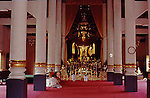 TEMPLE IN SOUTHEAST ASIA WITH GOLDEN BUDDHA