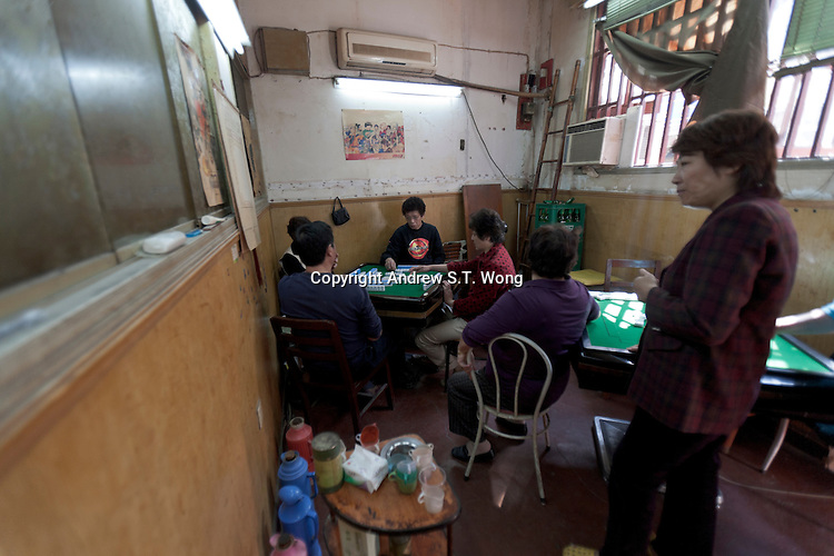 Chinese play a game of Mahjong in Shanghai, China on November 06, 2009.