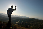 Erez Liberman, a settler, practices Tai-Chi during a solitary wandering, near the unauthorized Israeli outpost of Chavat Alumot, West Bank.