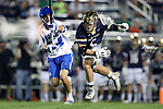 DURHAM, NC - APRIL 28: Notre Dame's John Travisano, Jr. (5) and Duke's Ethan Powley (44). The Duke University Blue Devils played the University of Notre Dame Fighting Irish on April 28, 2017, at Koskinen Stadium in Durham, NC in a 2017 ACC Men's Lacrosse Tournament Semifinal match. Notre Dame won the game 7-6.