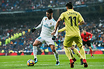Isco Alarcon (L) of Real Madrid is tackled by Jaume Vicent Costa Jorda, J Costa (R) and Manuel Trigueros Munoz of Villarreal CF during the La Liga 2017-18 match between Real Madrid and Villarreal CF at Santiago Bernabeu Stadium on January 13 2018 in Madrid, Spain. Photo by Diego Gonzalez / Power Sport Images