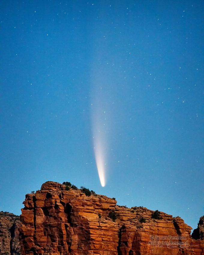 Comet NEOWISE Rising over Courthouse Butte (July 9).  This visitor from the far reaches of our solar system is giving us quite the sky show this summer (2020).  This photo was captured as the early twilight was turning into dawn.  Our clear sky over Sedona, Arizona made this image possible, and I also got a bit of help from the waning moon, which illuminated the red sandstone cliffs.<br /> <br /> Image ©2020 James D. Peterson