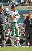Dan Marino watches from the sidelines after being removed from the game during the final game of the legendary quarterback's career, a 62 to 7 Playoff loss by his Miami Dolphins tot he Jacksonville Jaguars in Alltell Stadium, Jacksonville, FL, January 15, 2000. (Photo by Brian Cleary/www.bcpix.com)