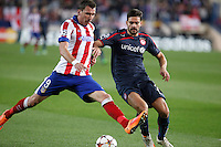 Atletico de Madrid´s Mandzukic (L) and Olympiacos´s Alberto Botia during Champions League soccer match between Atletico de Madrid and Olympiacos at Vicente Calderon stadium in Madrid, Spain. November 26, 2014. (ALTERPHOTOS/Victor Blanco) /NortePhoto