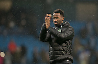 Moussa Dembele of Celtic applauds the support during the UEFA Champions League GROUP match between Manchester City and Celtic at the Etihad Stadium, Manchester, England on 6 December 2016. Photo by Andy Rowland.