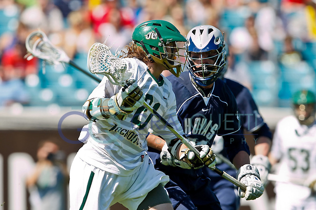 February 20, 2011:  Jacksonville Dolphins midfielder Donovan Lange (21) during Lacrosse action between the Georgetown Hoyas and Jacksonville Dolphins during the Moe's Southwest SunShine Classic played at EverBank Field in Jacksonville, Florida.  Georgetown defeated Jacksonville 14-11.