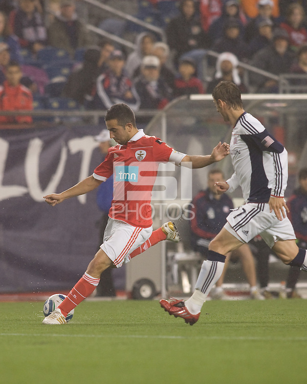 SL Benfica midfielder Ruben Amorim (5) crosses the ball as New England Revolution midfielder Ivan Gvozdenovic (17) closes. SL Benfica  defeated New England Revolution, 4-0, at Gillette Stadium on May 19, 2010.