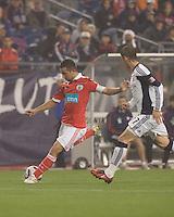SL Benfica midfielder Ruben Amorim (5) crosses the ball as New England Revolution midfielder Ivan Gvozdenovic (17) closes. SL Benfica  defeated New England Revolution, 4-0, at Gillette Stadium on May 19, 2010.