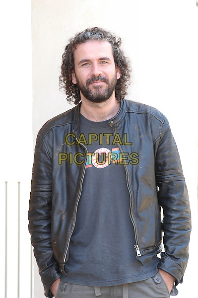 GUILLERMO TOLEDO.Photocall for film Crimen Ferpecto (2004).Rome, Italy, March 31st 2005..half length hands in pockets beard black leather jacket.Ref: CAV.www.capitalpictures.com.sales@capitalpictures.com.©Luca Cavallari/Capital Pictures.