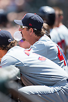 Salem Red Sox pitching coach Paul Abbott (44) blows a bubble during the game against the Winston-Salem Dash at BB&T Ballpark on May 31, 2015 in Winston-Salem, North Carolina.  The Red Sox defeated the Dash 6-5.  (Brian Westerholt/Four Seam Images)