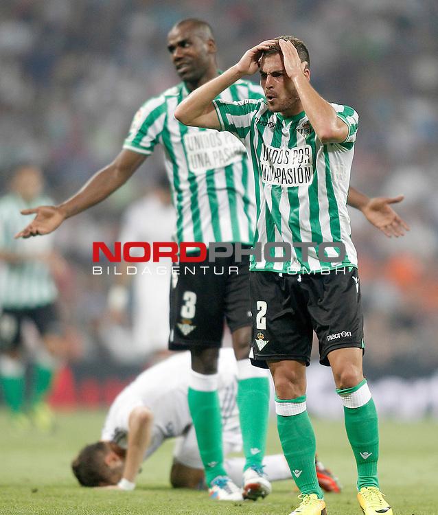 Betis' Paulao Alfonso Santos Jr (l) and Javier Chica during La Liga match.August 18,2013. Foto © nph / Acero)