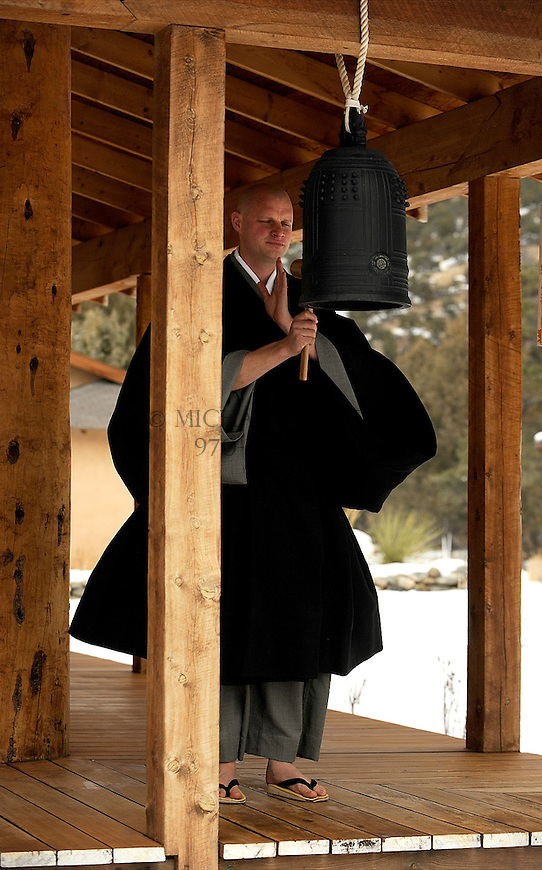 Zenki Christian Dillo strikes a densho-bell calling practicioners to service at the Crestone Mountain Zen Center. Michael Brands for The New York Times.