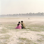 Young couple enjoy the evening on picnic Island in Patna, Feb 2014
