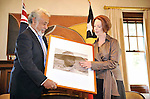 AUSTRALIA, Canberra : Xanana Gusmao Prime Minister of Timor-Leste is presented with a gift by Julia Gillard Prime Minister of Australia during meetings at the Lodge in Canberra Australia on February 18, 2012. AFP PHOTO / POOL Mark GRAHAM