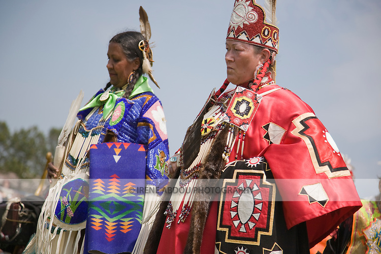 Native American women in full traditional regalia parade in the dance circle at the 8th Annual Red Wing PowWow in Virginia Beach, Virginia.