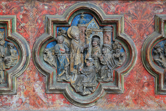 St Firmin curing a paralysed man, low relief plaque on the South side of the Gothic choir screen, 1490-1530, commissioned by canon Adrien de Henencourt, depicting the life of St Firmin, in the South ambulatory of the Basilique Cathedrale Notre-Dame d'Amiens or Cathedral Basilica of Our Lady of Amiens, built 1220-70 in Gothic style, Amiens, Picardy, France. St Firmin, 272-303 AD, was the first bishop of Amiens. Amiens Cathedral was listed as a UNESCO World Heritage Site in 1981. Picture by Manuel Cohen