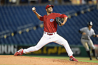 Clearwater Threshers relief pitcher Miguel Alfredo Gonzalez (48) delivers a pitch during a game against the Tampa Yankees on June 26, 2014 at Bright House Field in Clearwater, Florida.  Clearwater defeated Tampa 4-3.  (Mike Janes/Four Seam Images)