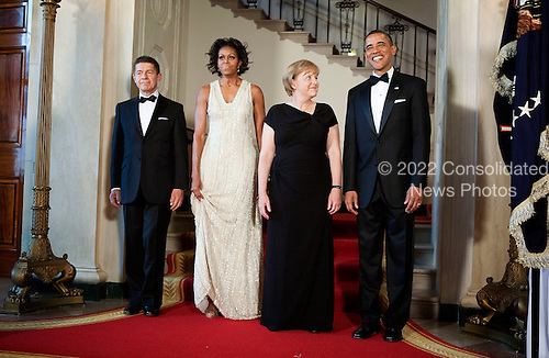 From right, United States President Barack Obama, Angela Merkel, chancellor of Germany, First Lady Michelle Obama and Joachim Sauer, Merkel's husband, poses for a portrait at the White House in Washington, D.C., U.S., on Tuesday, June 7, 2011. .Credit: Joshua Roberts / Pool via CNP