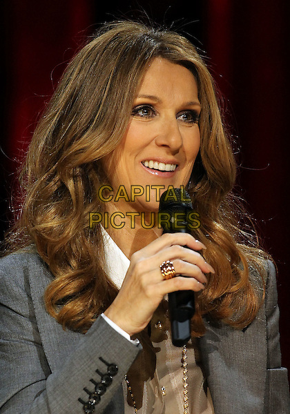 CELINE DION.Celine Dion's Momentous Return To The Colosseum Press Conference At Caesars Palace Resort Casino, Las Vegas, Nevada, USA..March 15th, 2011.headshot portrait grey gray jacket gold ring necklace beige shirt blouse microphone .CAP/ADM/MJT.© MJT/AdMedia/Capital Pictures.