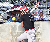 RICK PECK/SPECIAL TO MCDONALD COUNTY PRESS McDonald County's Adasyn Leach ducks away from a pitch during the Lady Mustangs' 14-4 loss to Nevada to close out its summer season. McDonald County will have a camp in July before practices for the fall season begin Aug. 12.