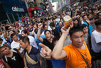 Angry men, many of whom are paid anti-Occupy Central protesters, are seen prior to clashes with pro-democracy protesters in Mong Kok on day six of the mass civil disobedience campaign Occupy Central, Mong Kok, Kowloon, Hong Kong, China, 02 October 2014. Pro-democracy protesters and foreign media were beseiged by a angry mob of paid pro-China goons for several hours as Hong Kong police were slow to bring in reinforcements to bring the situation under control. Several injuries were reported as anti-Occupy Central goons beat up several pro-democracy protesters.