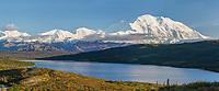 Hikers view the Alaska Range mountains and Mt. Denali by Wonder Lake, Denali National Park, Alaska.