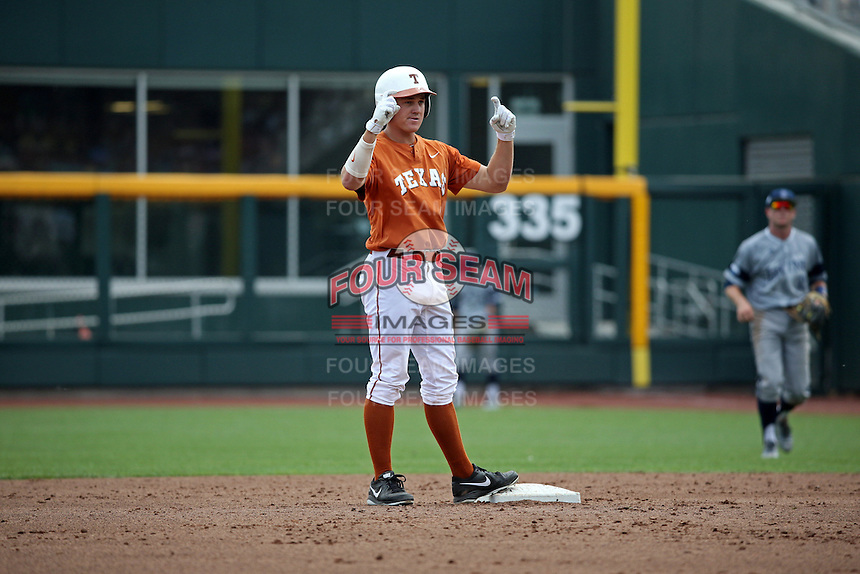 Collin Shaw #4 of the Texas Longhorns celebrates during Game 1 of the 2014 Men's College World Series between the UC Irvine Anteaters and Texas Longhorns at TD Ameritrade Park on June 14, 2014 in Omaha, Nebraska. (Brace Hemmelgarn/Four Seam Images)