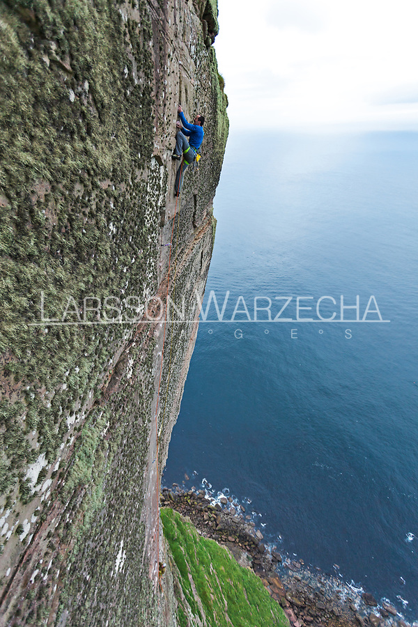 Dave Macleod on the first free ascent of the 'Longhope Route Direct' E11 7a, 21st June 2011, St John's Head, Hoy