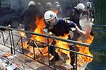 A riot policeman burnt when protesters throwed fire bombs to the police. Thousands of Athenians demonstrate the Labour Day in Central Athens.