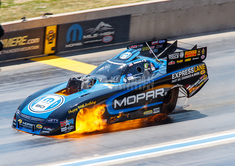 Jul 23, 2017; Morrison, CO, USA; NHRA funny car driver Matt Hagan explodes an engine on fire during the Mile High Nationals at Bandimere Speedway. Mandatory Credit: Mark J. Rebilas-USA TODAY Sports