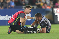Rhys Webb of Ospreys is seen to by physios during the Champions Cup Round 1 match between Ospreys and Clermont at The Liberty Stadium, Swansea, Wales, UK. Sunday 15 October 2017