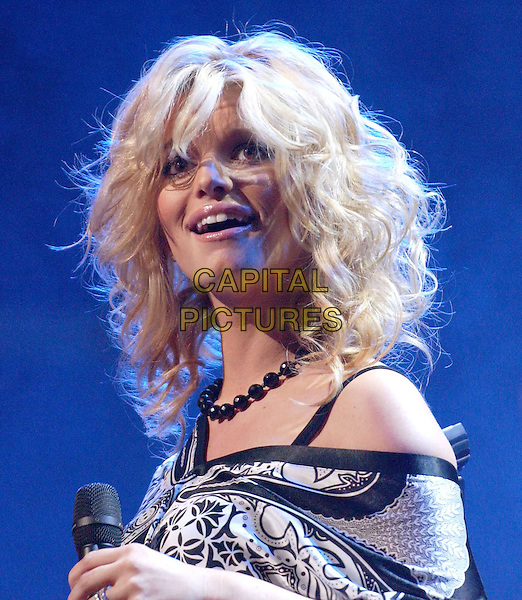 JESSICA SIMPSON.performs at the102.7 KIIS-FM's 3rd Annual Jingle Ball held at The Staples Center in Los Angeles, California .05 December 2003.live, music, stage, concert, gig, funny face.www.capitalpictures.com.sales@capitalpictures.com.©Capital Pictures.