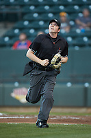 Home plate umpire Austin Jones tracks a fly ball during the game against the Lynchburg Hillcats at BB&T Ballpark on May 1, 2018 in Winston-Salem, North Carolina. The Dash defeated the Hillcats 9-0. (Brian Westerholt/Four Seam Images)