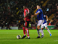 Lincoln City's John Akinde shields the ball from Everton's Michael Keane<br /> <br /> Photographer Chris Vaughan/CameraSport<br /> <br /> The Carabao Cup Second Round - Lincoln City v Everton - Wednesday 28th August 2019 - Sincil Bank - Lincoln<br />  <br /> World Copyright © 2019 CameraSport. All rights reserved. 43 Linden Ave. Countesthorpe. Leicester. England. LE8 5PG - Tel: +44 (0) 116 277 4147 - admin@camerasport.com - www.camerasport.com