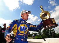 May 6, 2012; Commerce, GA, USA: NHRA funny car driver Ron Capps celebrates after winning the Southern Nationals at Atlanta Dragway. Mandatory Credit: Mark J. Rebilas-