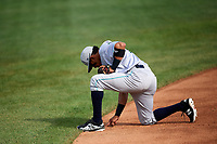 Lynchburg Hillcats third baseman Jorma Rodriguez (9) takes a knee to write in the infield dirt during the first game of a doubleheader against the Frederick Keys on June 13, 2018 at Nymeo Field at Harry Grove Stadium in Frederick, Maryland.  Frederick defeated Lynchburg 3-0.  (Mike Janes/Four Seam Images)