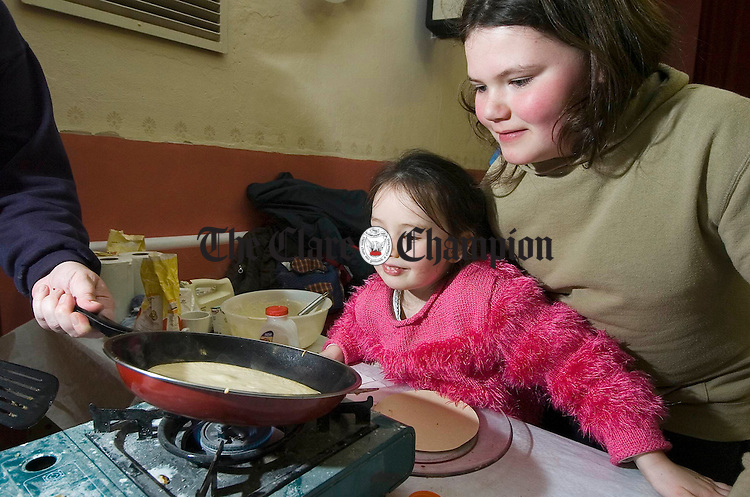 Jessica Doohan gets a peep at a pancake in the making with a little help from Mairead Clancy at the Mullagh Brownies Pancake Party in aid of the National Childrens Hospital in Tallaght. Photograph by John Kelly.