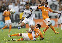 CARSON, CA - DECEMBER 01, 2012:   Sean Franklin (5) of the Los Angeles Galaxy steps over Jermaine Taylor (4) of the Houston Dynamo during the 2012 MLS Cup at the Home Depot Center, in Carson, California on December 01, 2012. The Galaxy won 3-1.