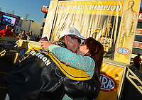 Nov. 11, 2012; Pomona, CA, USA: NHRA funny car driver Jack Beckman celebrates with wife Jenna Beckman after clinching the 2012 championship during the Auto Club Finals at at Auto Club Raceway at Pomona. Mandatory Credit: Mark J. Rebilas-