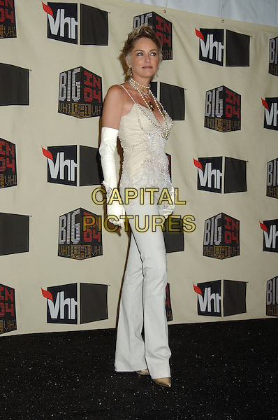 SHARON STONE.VH1 Big in '04 held at the Shrine Auditorium. .December 1st, 2004.full length, cream, beige trousers, pearl necklaces, jewellery, white gloves.www.capitalpictures.com.sales@capitalpictures.com.© Capital Pictures.