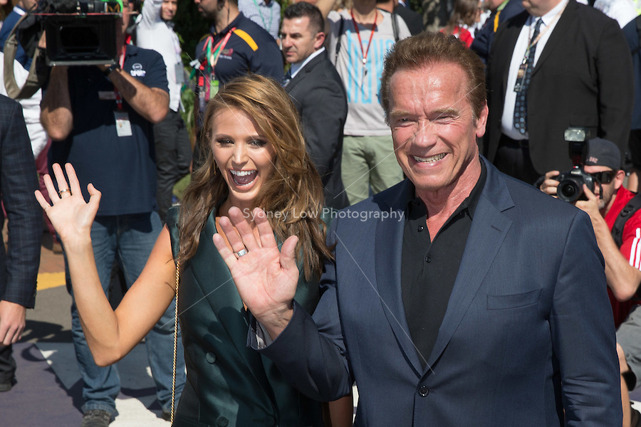 March 20, 2016: Arnold Schwarzenegger and the ambassador of the Australian Grand Prix Brittany Davis pose for photographs before the start of the 2016 Australian Formula One Grand Prix at Albert Park, Melbourne, Australia. Photo Sydney Low