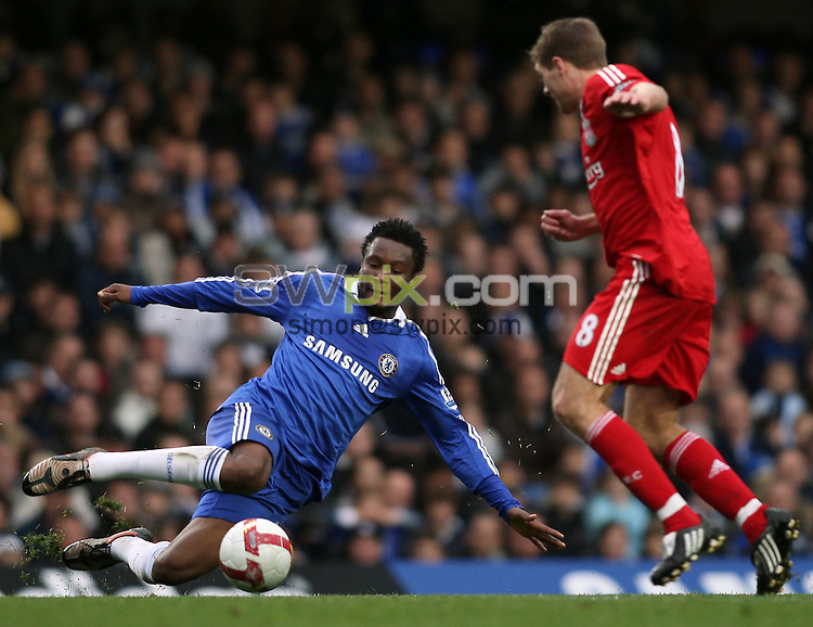 PICTURE BY JEREMY RATA/SWPIX.COM. Barclays Premier league 2008/9 - Chelsea v Liverpool - Stamford Bridge, London, England. 26th October 2008. Chelsea's John Mikel Obi dives into the tackle on Liverpool's Steven Gerrard...Copyright - Simon Wilkinson - 07811267706