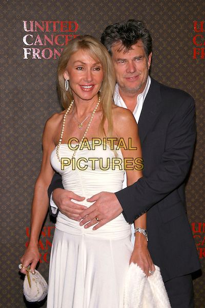 LINDA THOMPSON & DAVID FOSTER.The 2nd Annual Louis Vuitton United Cancer Front Gala, Universal City, California, USA,.November 8th 2004..half length white strapless dress hugging.Ref: ADM.www.capitalpictures.com.sales@capitalpictures.com.©Capital Pictures.