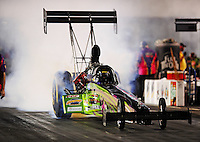 Sept. 17, 2010; Concord, NC, USA; NHRA top fuel dragster driver Doug Foley does a burnout during qualifying for the O'Reilly Auto Parts NHRA Nationals at zMax Dragway. Mandatory Credit: Mark J. Rebilas/
