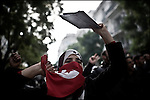 "© Remi OCHLIK/IP3 - Tunis the 18 january 2011 Around Bourguiba avenue, Tunisian protestors try to demonstrate, asking for the Ben Ali party, the RDC be disolve.  Anti riots policemen spread tear gaz and beat them with their sticks..Tunisia took a step toward democracy and reconciliation Monday, promising to free political prisoners and opening its government to opposition forces long shut out of power -- but the old guard held onto the key posts, angering protesters..Demonstrators carrying signs reading ""GET OUT! demanded that the former ruling party be banished altogether -- a sign more troubles lie ahead for the new unity government as security forces struggle to contain violent reprisals, shootings and looting three days after the country's longtime president fled under pressure from the streets."