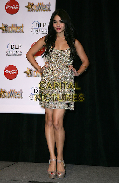 VANESSA HUDGENS .SHOWEST Final Night Talent Awards at the Paris Resort Hotel and Casino,  Las Vegas, Nevada , USA,.18th March 2010..full length gold beaded jewel encrusted embellished dress hands on hips brown peep toe platform shoes ankle strap .CAP/ADM/MJT.© MJT/AdMedia/Capital Pictures.