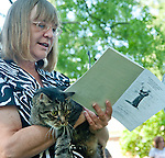 "Photo by Phil Grout..Sharon Maloon follows the responsive reading while her friend, ""Pepper"", waits for the.special Blessing of the Animals during services at Westminster Ascension Church.."
